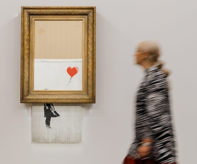 """Banksy's """"Love is in the Bin"""" is His Most Expensive Work"""